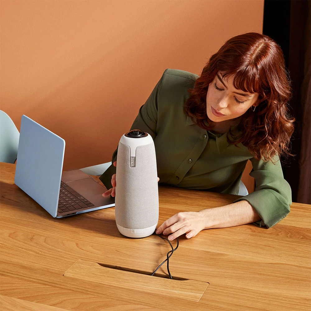 Woman Plugging in Meeting Owl Pro